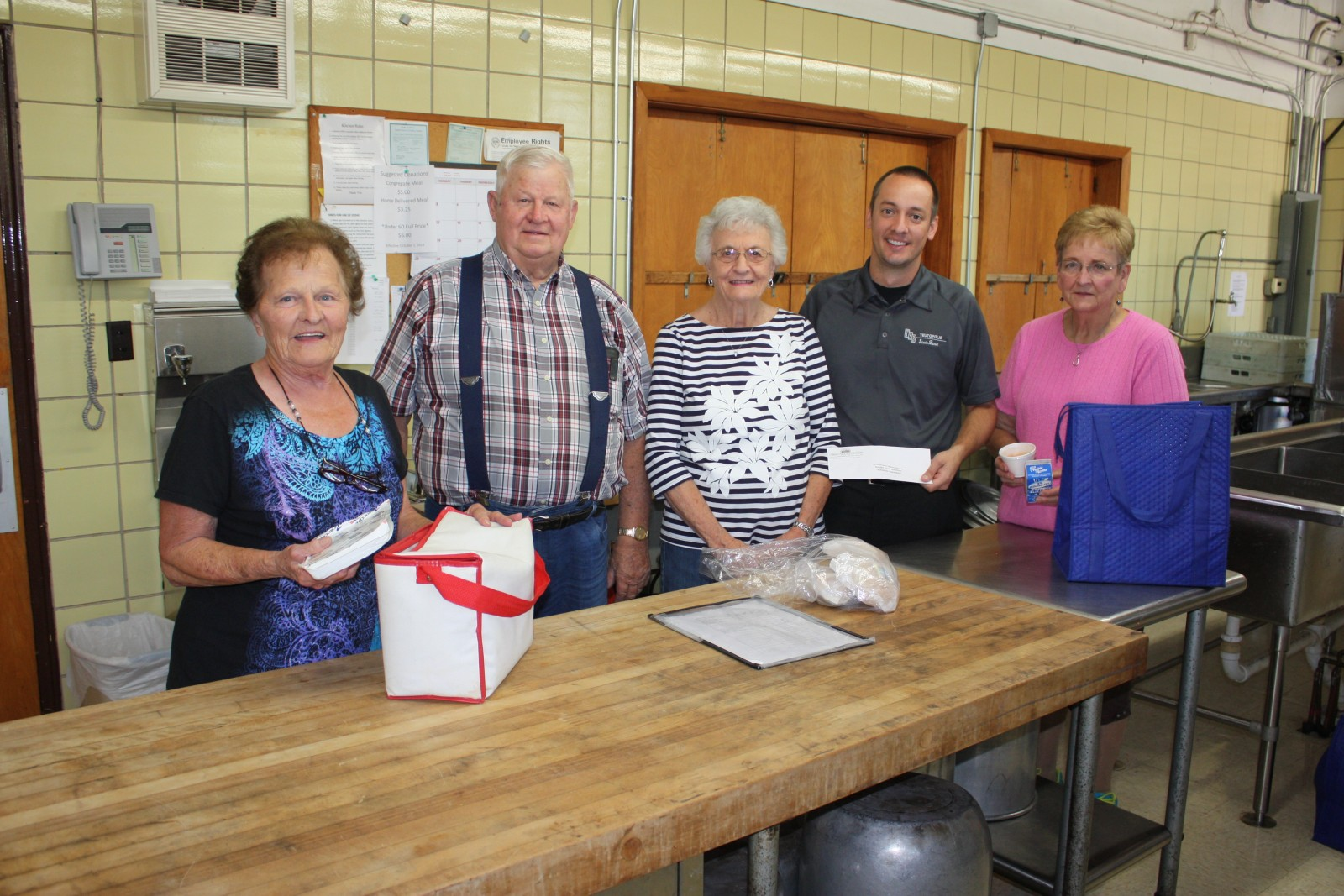 Representatives of the Teutopolis site of CEFS/Golden Circle Nutrition Program recently accepted a grant from Teutopolis State Bank. Pictured (L-R): Mable Harris, George Westendorf, Jeanette Westendorf, Jerry Runde (Teutopolis State Bank representative), and Nancy Hoene.