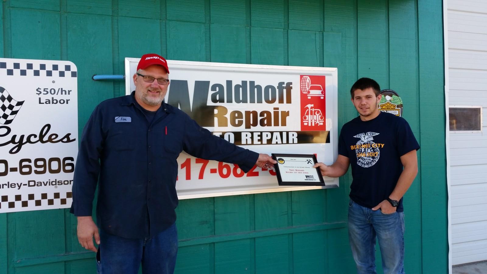 "Tim Waldhoff presents Trey Buzzard with the ""Top Shop"" Award."