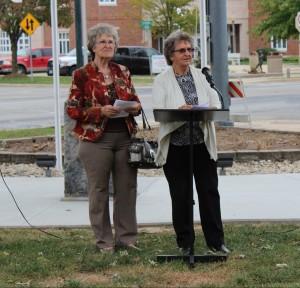 Arnetia Osborn and Bonnie Mellendorf speak at the flagpole dedication held on Tuesday.