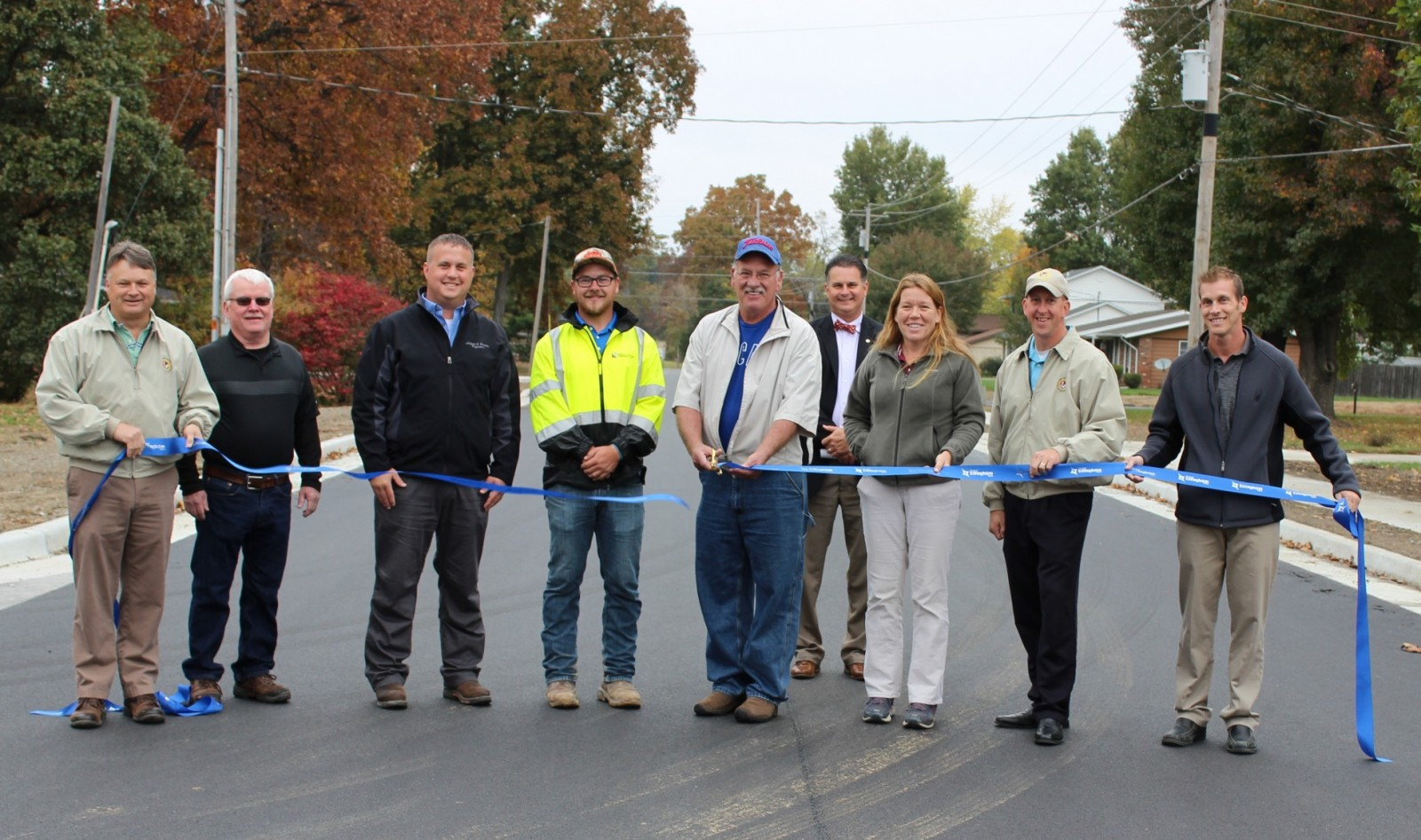 City Officials and Contractors who worked on the N. Raney Street Road Project open the street to through traffic Thursday morning. City Commissioner Don Althoff cut the ribbon.
