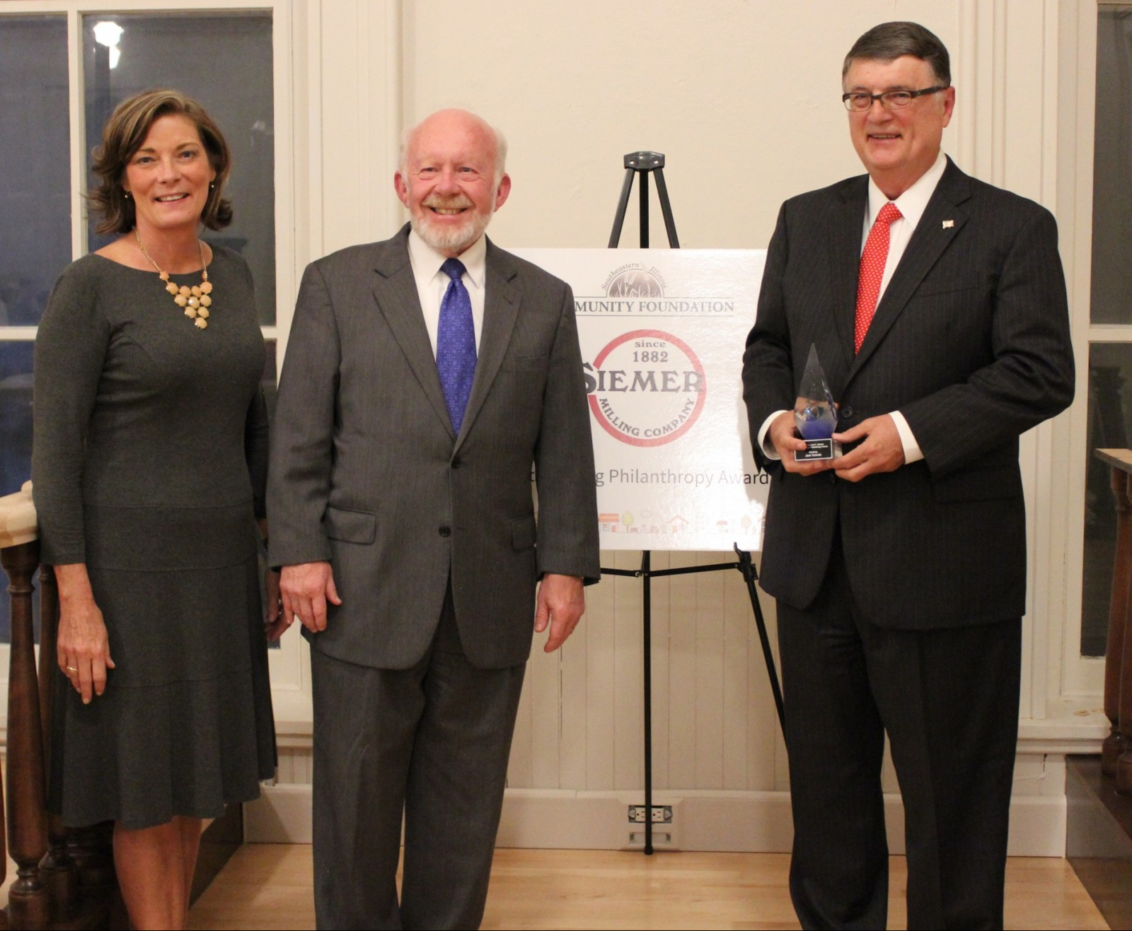 Pictured L-R Community Foundation President/CEO Joedy Hightower, Rick President/CEO of SIemer Milling, and former award recipient Rick Siemer, and Outstanding Philanthropist Award recipient Jack Schultz.
