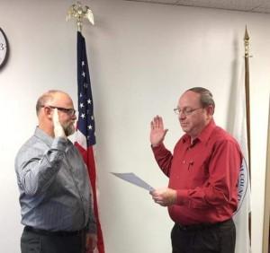 County Clerk Kerry Hirtzel swear in John Perry to the Effingham County Board. Photo courtesy of Elizabeth Huston.