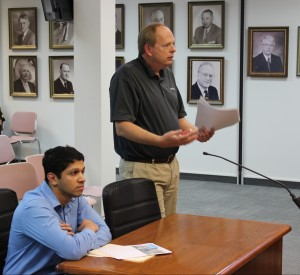 Arpit Shah (left) and Director of Economic Development Todd Hull (right) discuss improvements to America's Best Value Inn.