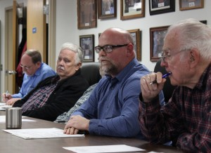 Board Member John Perry dicusses possible cuts to the county budget.  (Pictured L-R) County Clerk Kerry Hirtzel, Board Members Dave Campbell, Jeff Simpson, John Perry, Lloyd Foster.