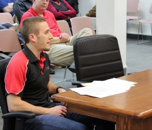 Blake Yager addresses the city council about the amusement tax.