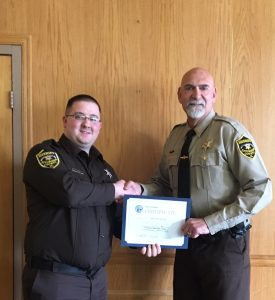 C.O. Mathew Brown (left) with Sheriff David Mahon (right) at the graduation ceremony.